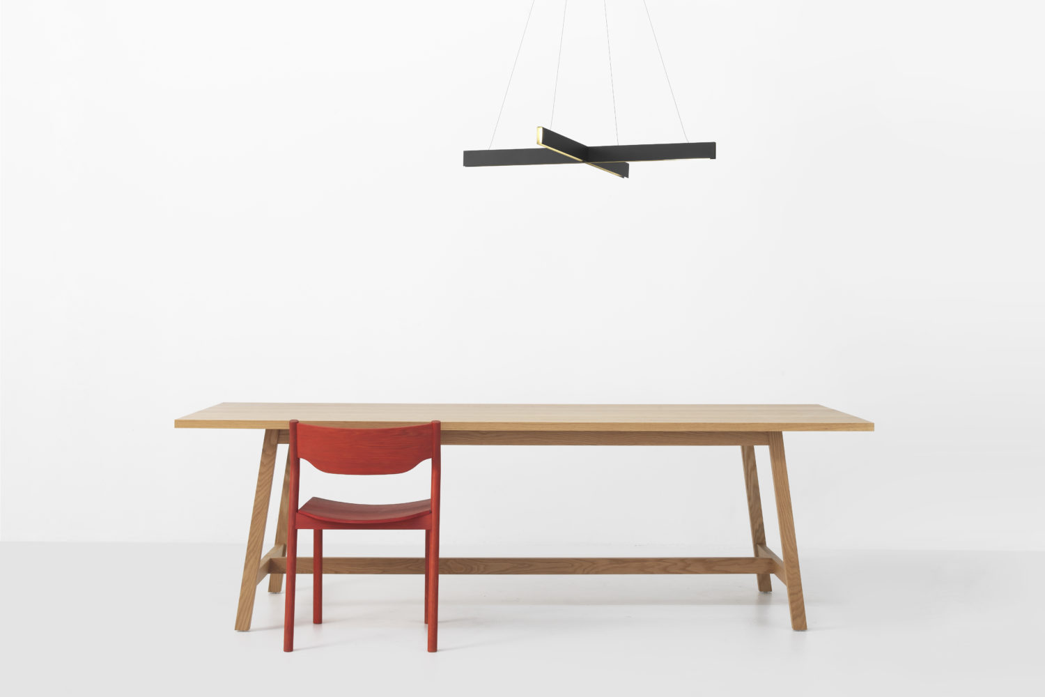 Resident Cross Pendant   Hawk Table   Tangerine Chair
